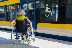Woman in wheelchair on train platform
